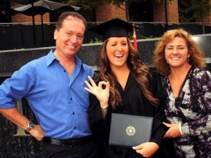 Proud parents, and even more proud graduate.